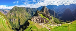 Panorama of the Machu Picchu or Machu Pikchu panoramic view in Peru. Machu Picchu is a Inca site located in the Cusco Region in Peru. Machu Picchu is one of the New Seven Wonders of the World.