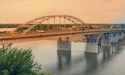 Panorama of the metallic bridge and sunset over the Belaya (White) River in Ufa, Bashkiria, Russia