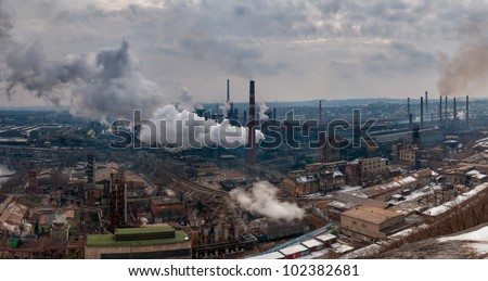 Panorama of the metallurgical factory with pipes and smoke, atmosphere pollution