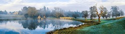 Panorama of the morning mist over the pond. Misty morning fog ove pond. Misty morning pond panorama. Pond panorama in morning