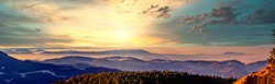 Panorama of the mountain landscape in the Northern Black Forest at sunrise