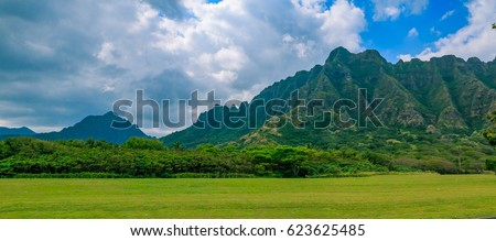 "Panorama of the mountain range by Kualoa Ranch in Oahu, Hawaii. Famous movies and TV shows like ""Lost"", ""50 First Kisses"" and ""Jurassic Park"" were filmed here #623625485"