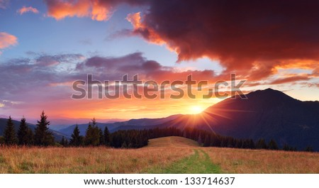 Panorama of the mountains with a beautiful sunset and the sun with rays #133714637
