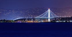 Panorama of the new span of the Bay Bridge from San Francisco to Oakland viewed from Marina District in San Francisco, California, USA. Long exposure