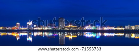 Panorama of the night city in neon lights