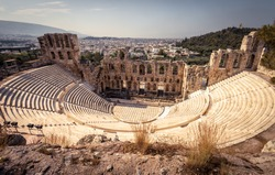 Panorama of the Odeon of Herodes Atticus at the Acropolis of Athens, Greece. Classical theater of Herod is one of main landmarks of Athens. Scenic view of Ancient Greek ruins overlooking Athens city.