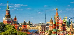 Panorama of the old Red Square with Moscow Kremlin and St Basil's Cathedral in summer, Moscow, Russia. It is the best-known sights of Moscow. Beautiful view of the heart of sunny Moscow.