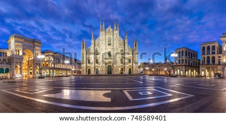 Panorama of the Piazza del Duomo, Cathedral Square, with Milan Cathedral or Duomo di Milano, Galleria Vittorio Emanuele II and Arengario, during morning blue hour, Milan, Lombardia, Italy #748589401