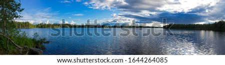 Panorama of the reach on the Keret river with beautiful clouds. Karelia, Russia, end of June. Stock fotó ©