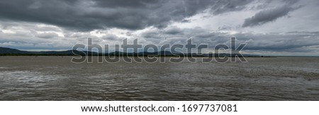 Panorama of the River on a Cloudy Day   Irrawaddy River, Old Bagan, Myanmar Photo stock ©