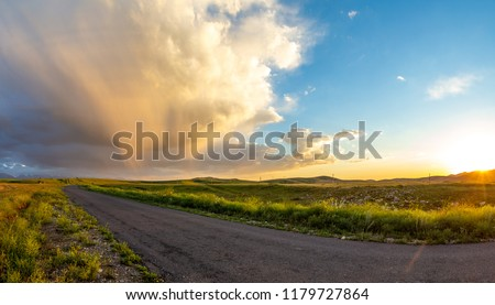 Panorama of the road at sunset in the high plateau.