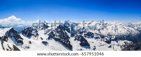 Panorama of the snow mountain range mountain range from the Titlis is a mountain of the Uri Alps Engelberg, Switzerland.