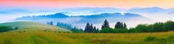 Panorama of the summer morning in the foggy Carpathian mountains. Borzhava ridge, Transcarpathian, Ukraine, Europe.