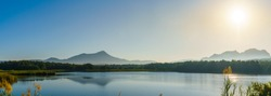 Panorama of the sunrise in the morning with mountain, lake and sky at Mae Mo, Lampang, Thailand.