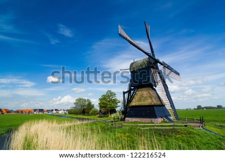 Panorama of the traditional Dutch windmill near the channel. Netherlands