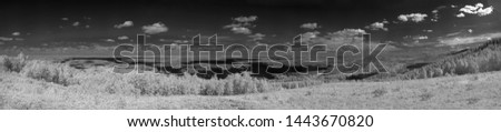 Panorama of the Ural Mountains. View from the village of Vishnevogorsk towards the town of Kasli. Infrared photo, monochrome