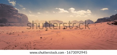 Panorama of the Wadi Rum desert in Jordan during a slight sand storm