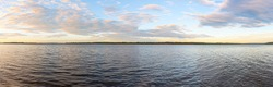 Panorama of the wide river on a summer evening