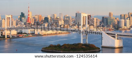 Panorama of Tokyo as seen from Odaiba at sunrise, with the Rainbow Bridge and Tokyo Tower