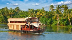 Panorama of tourist houseboat on Kerala backwaters. Kerala, India