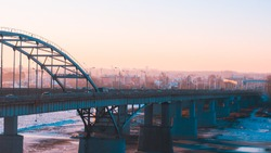 panorama of transport on the bridge and sunrise over the Belaya River in Ufa, Bashkiria, Russia