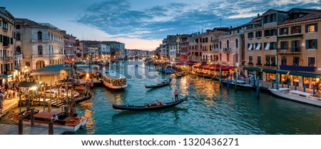 Panorama of Venice at night, Italy. Beautiful cityscape of Venice in evening. Panoramic view of Grand Canal at dusk. It is one of the main tourist attractions of Venice. Romantic water trip in Venice. #1320436271