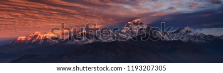 Panorama of warm, pink sunrise light over Annapurna mountain range with beautiful clouds, view from Poon hill in Himalayas, Nepal #1193207305