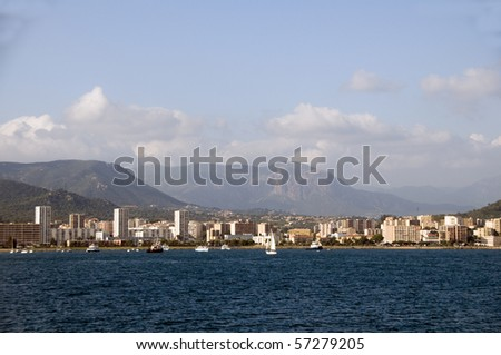 panorama of waterfront with hotels retail stores landscape with mountains ajaccio corsica france mediterranean sea