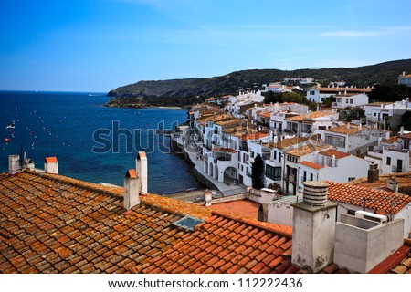 Panorama of white fishing village houses in Cadaques, Spain and Mediterranean coastline