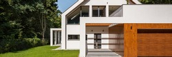 Panorama of white modern and beautiful house with garage in forest