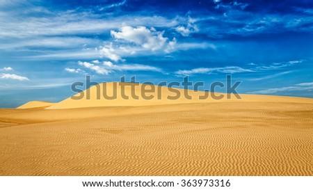 Panorama of White sand dunes in desert on sunrise, Mui Ne, Vietnam.
