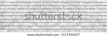 Panorama of White stone brick wall seamless background #1117454627
