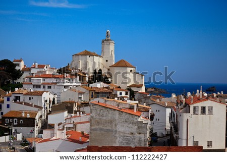 Panorama of white village houses and church bell tower in Cadaques, Spain