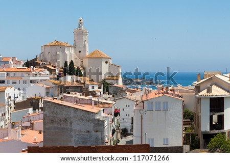 Panorama of white village houses and church tower in Cadaques, Spain
