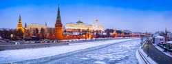 Panorama of winter Moscow. Сapital of Russia. Kremlin, Kremlin wall, churches, Grand Kremlin Palace. Moscow river under the ice. Embankment. Business card of Moscow.