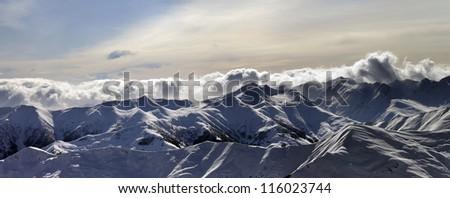 Panorama of winter mountains at sunset. Caucasus Mountains, Georgia, Gudauri.