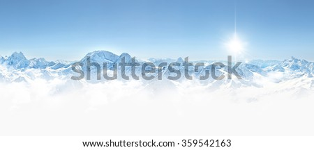 Panorama of winter mountains in Caucasus region,Elbrus mountain, Russia, with sun and copy space #359542163