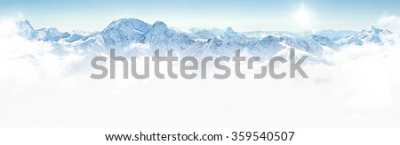 Panorama of winter mountains with clouds, bright sun and copy space #359540507