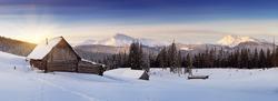 Panorama of winter mountains with houses of shepherds. Carpathians, Ukraine, Europe