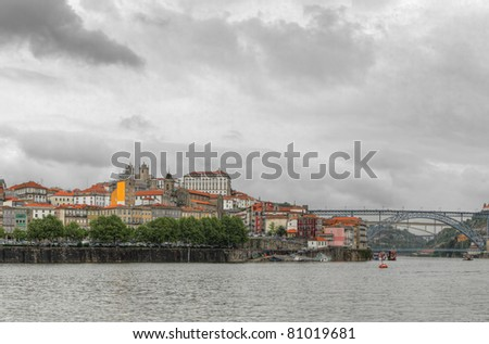 Panorama old Porto river Duoro,with boats, old town, town of Gaia and famous bridge Ponte dom Luis, Oporto, Portugal
