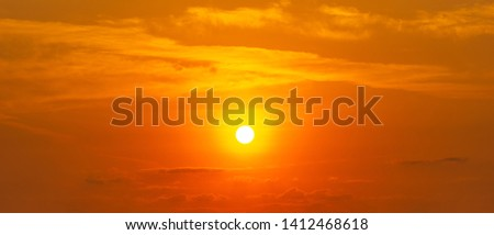 Panorama orange sky and cloud with brightness sun, beautiful nature background #1412468618