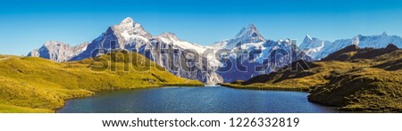 Panorama over the Bachalpsee during the famous hiking trail from First to Grindelwald (Bernese Alps, Switzerland). You can have great views on mountains like the Eiger, Monch and Jungfrau. #1226332819