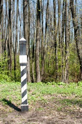 Panorama park. Kilometer, zero post in the clearing. Warm spring day.