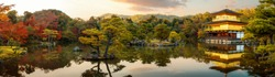 Panorama photo for Kinkakuji castle with autumn background and sunset, Goldent temple,  The traditional vintage pavilion in Kyoto city, Japan