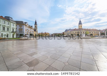 Panorama photo of aeuropean city, the historic center of Oraedea, Romania. Union square (Piata Unirii) with historical buildings.
