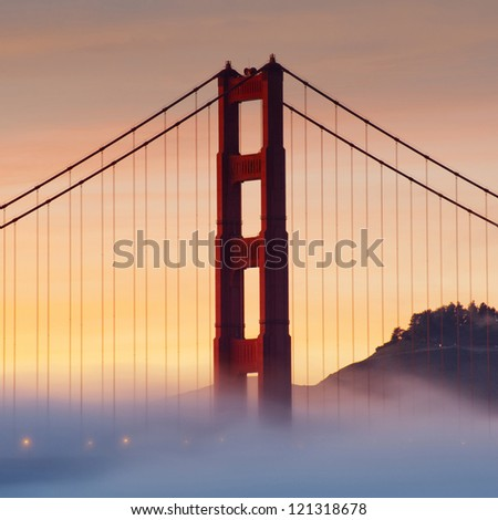 Panorama photo of Golden Gate Bridge at sunset with fog, San Francisco, USA