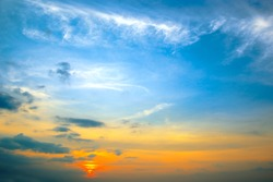 Panorama photo spring sunset with blue sky, white clouds and red sun.