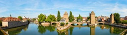 panorama picture of the three bridges Pont Couverts over the river Ill in Strasbourg, France