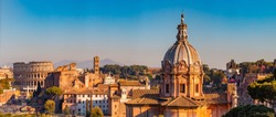 Panorama Rome Italy, sunset city Colosseum ruins Roman Forum from square of Venice.