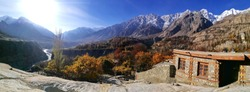 Panorama shot of colorful autumn landscape and snow mountain scenery from Altit fort in Hunza valley. Gilgit Baltistan, Pakistan.